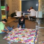 It is all hands on deck as the team finds ways to get their blankets made. 150x150 Hands Across the Bay