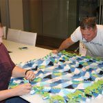 More teamwork getting the blankets complete to help those in need. 150x150 Hands Across the Bay
