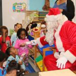 Santa gladly hands out gifts to all the kids. 150x150 Potter Elementary School